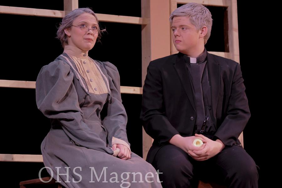 Miss Prism (Jaylin Evert) and Reverend Chasuble (Ethan Pick) find themselves in pleasant conversation