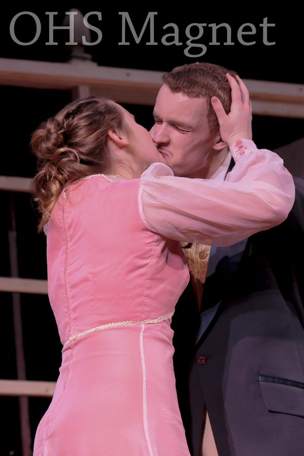 Cecily Cardew (Avery Oja) and Algernon Moncrieff (Matthew Reinhard) seal their new engagement with a kiss