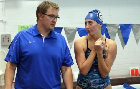 Mattie Shaver talks to head coach Isaiah Fuller in preparation for her next race