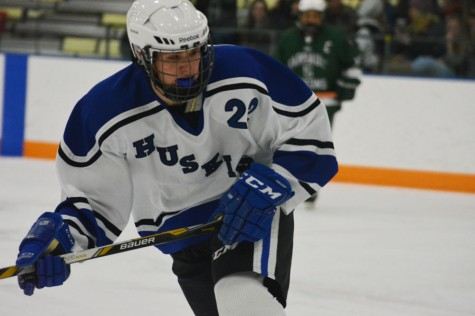 Junior Michael Brien goes after the puck