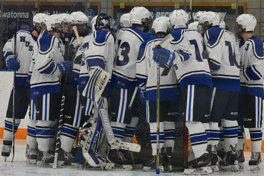 The Owatonna Boys Hockey team huddles before the game
