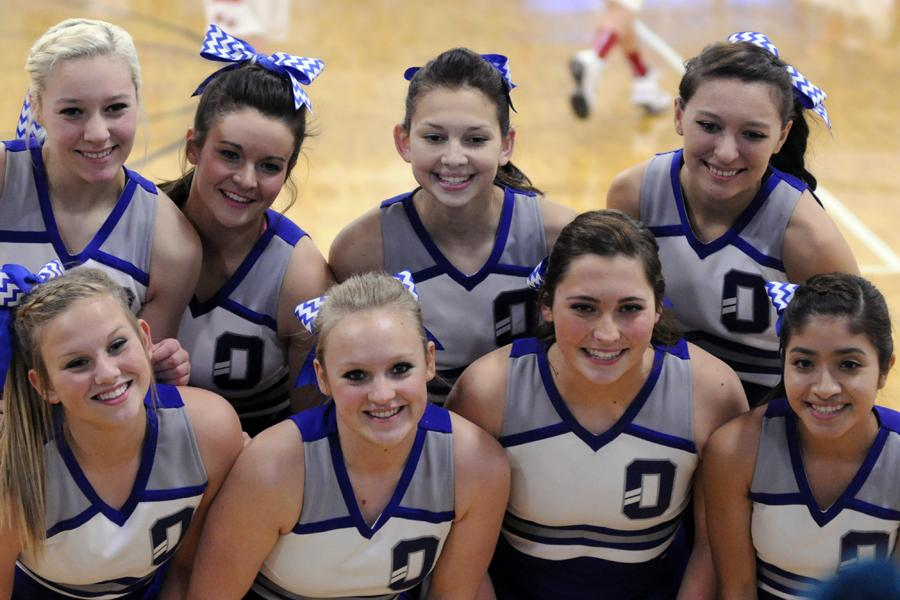 Cheerleaders pose for a picture