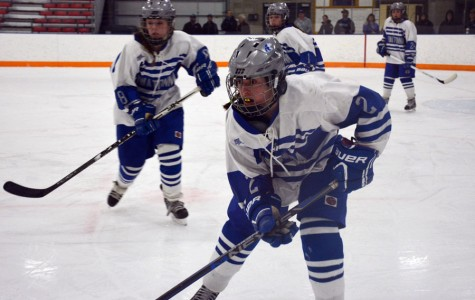 Freshman Rilee Shmidt waiting to receive the puck