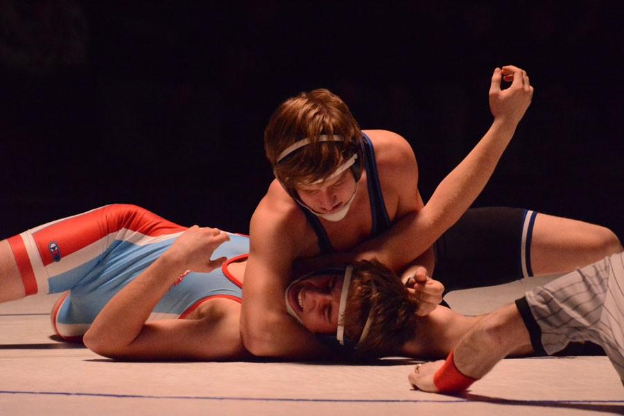 Senior Christian Reese pins his Albert Lea opponent
