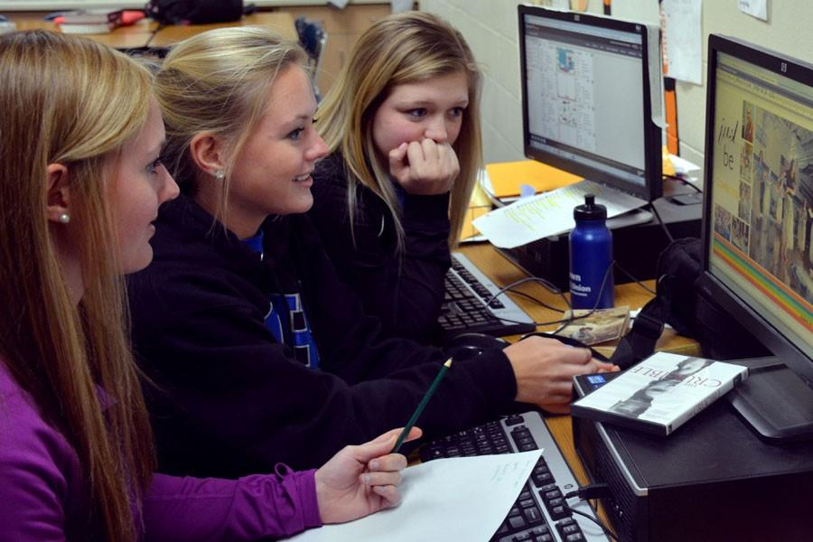 Kayla Kniefel, Krista Kniefel and Allie Mayer editing the yearbook