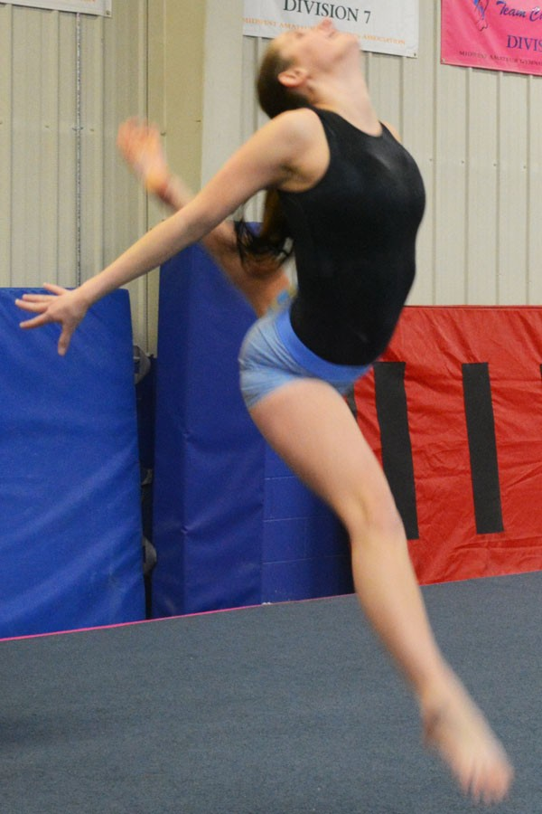Senior captain Tatelyn Blazek performs a ring leap