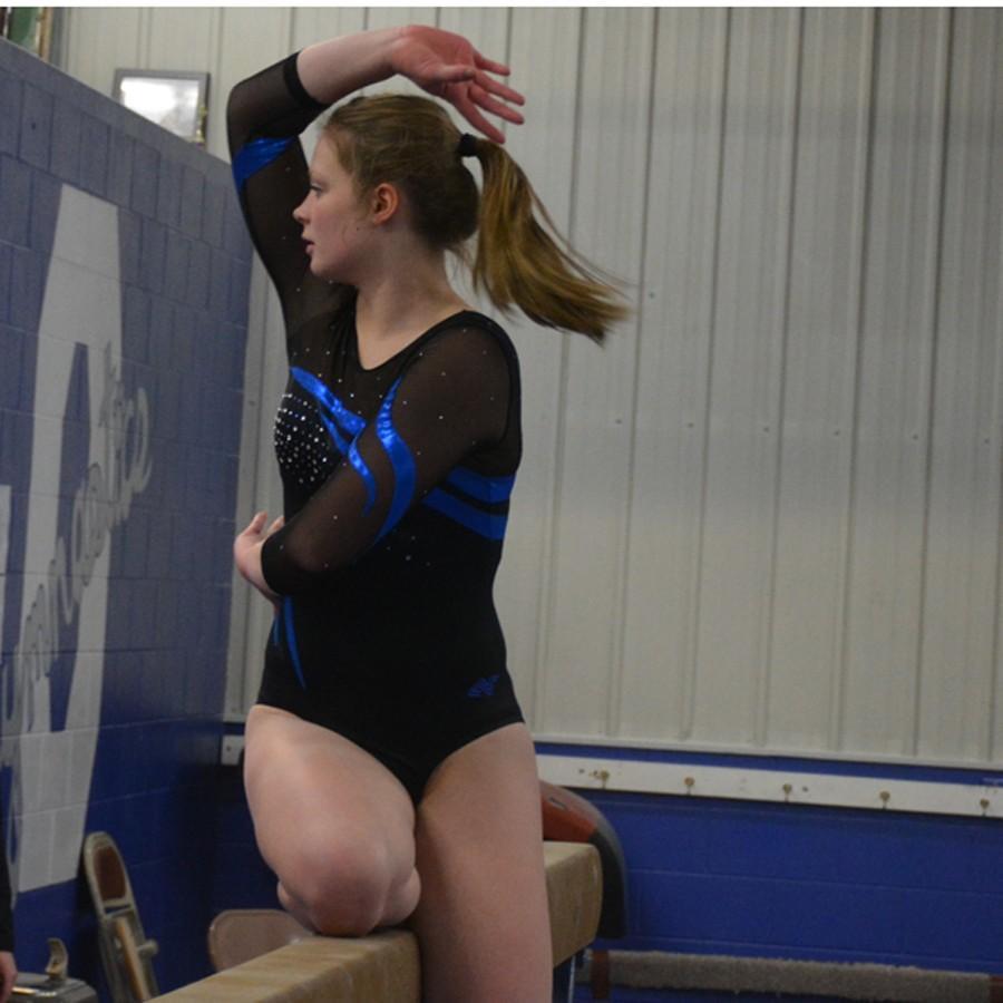 Freshman+Erica+Svenby++strikes+a+pose+on+the+balance+beam
