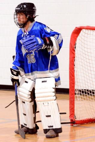 Number 15, Nick Abernathey prepares to block the goal.