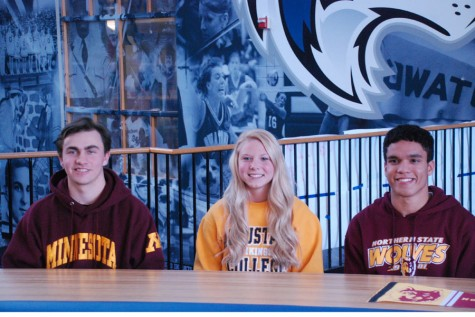 National Signing Day!  (L- R) Pete Jones- University of Minnesota, Twin Cities for Golf  Kaylea Ahrens- Augustana University (SD)- for Volleyball Zae LeFaive-Northern University (SD) for Track & Field