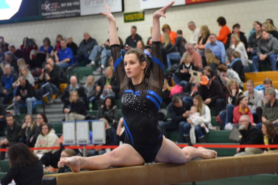 Senior Captain Tatelyn Blazek Poses on the balance beam