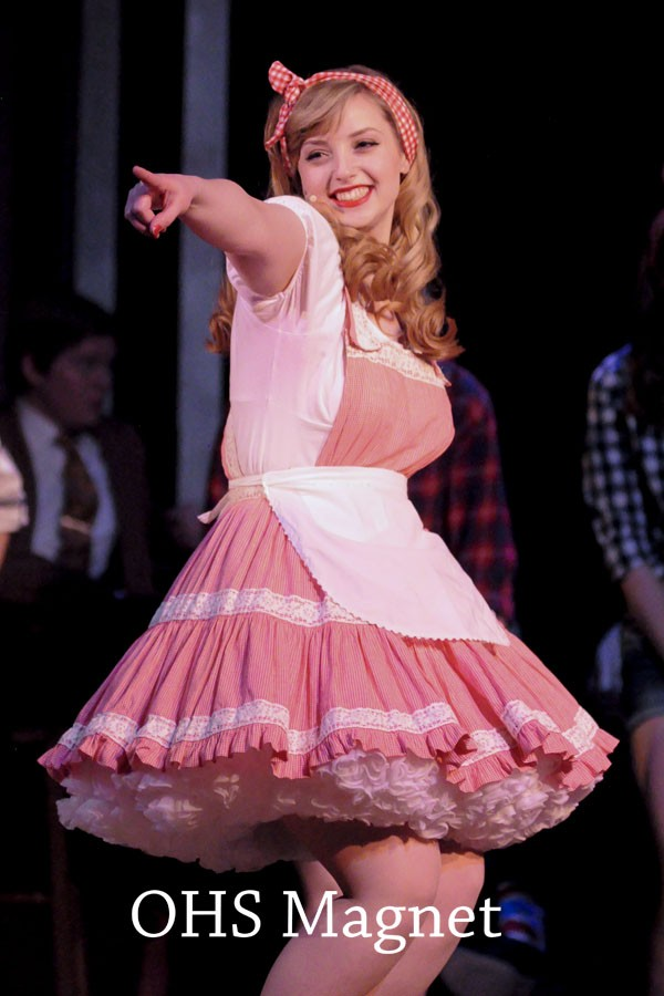 Miss Adelaide (Jessica Friedman) points to a special audience member