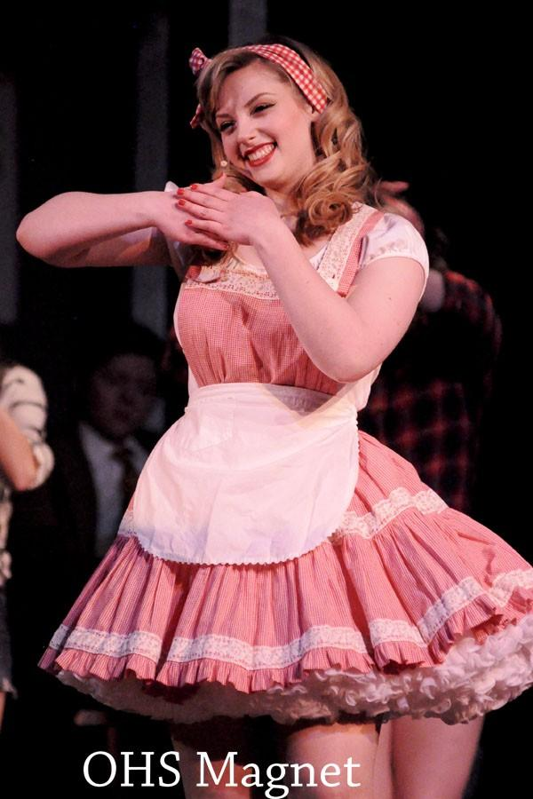 Miss Adelaide (Jessica Friedman) gives her best smile to the audience of men surrounding her