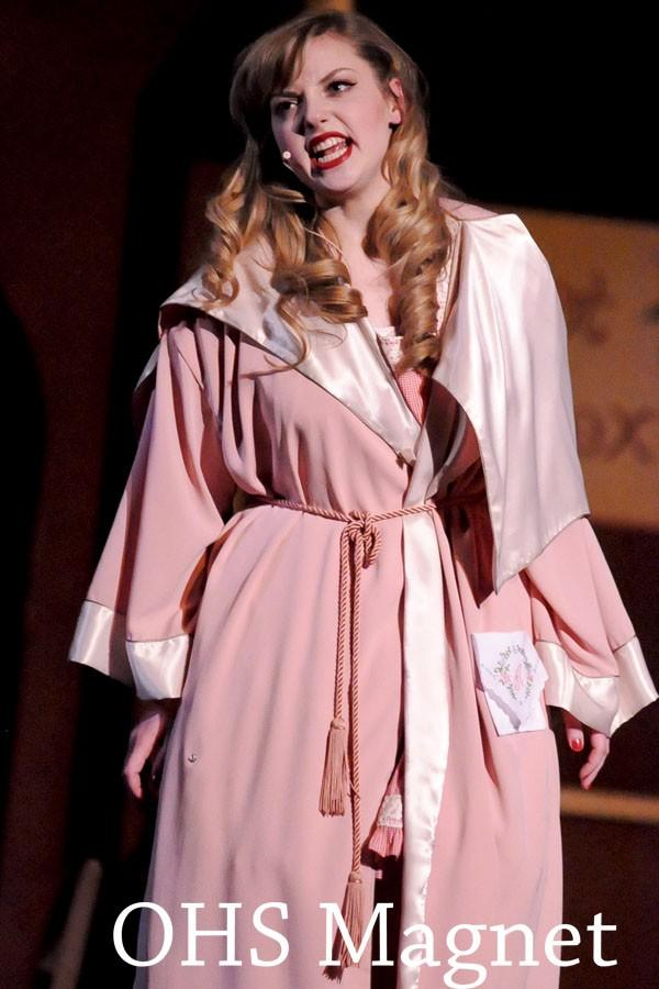 Miss Adelaide (Jessica Friedman) sings her discontent with her 14 year engagement and consequent cold in Adelaides Lament