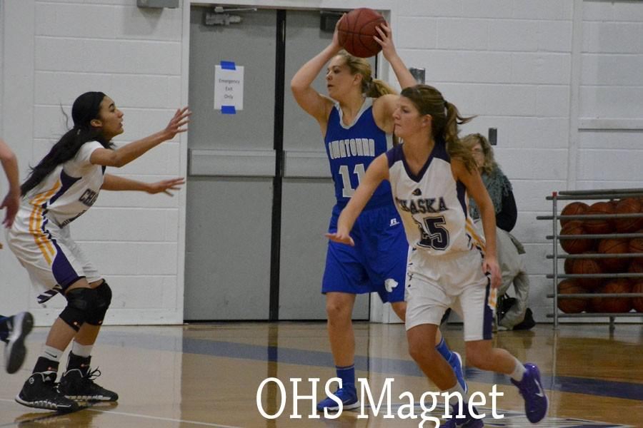 Junior Carli Langeland keeps the ball away from her opponents