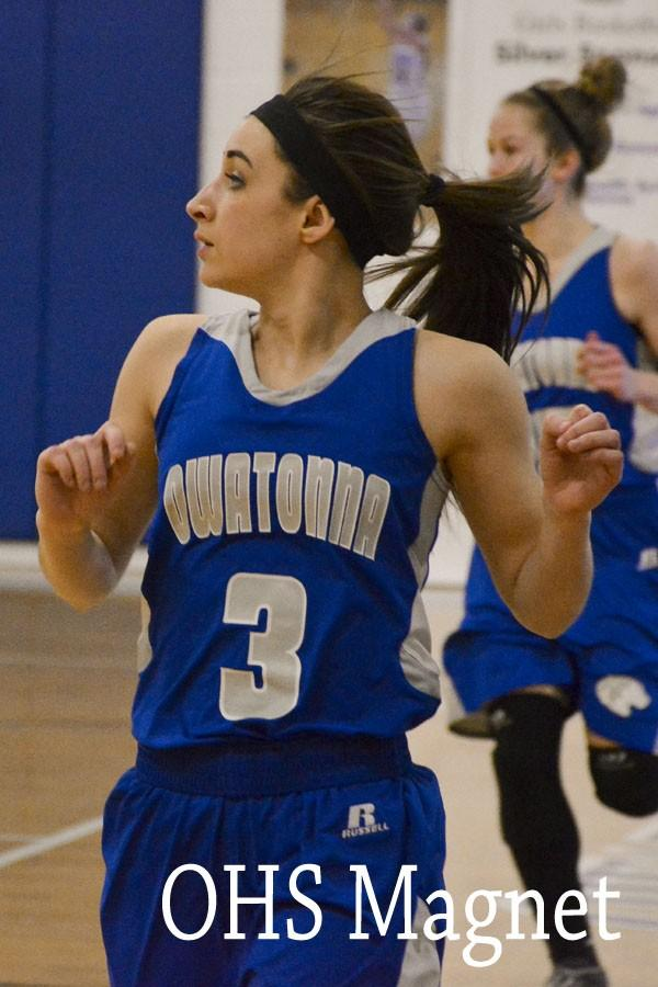 Sydney Kasper runs down the court, keeping her eye on the ball