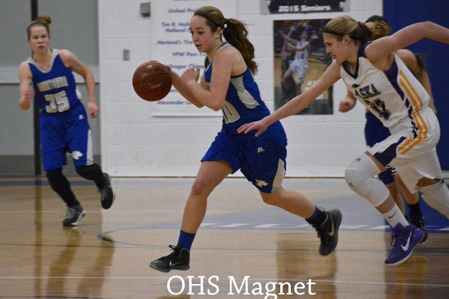 Sydney Schultz keeps the ball away from the Chaska Hawks