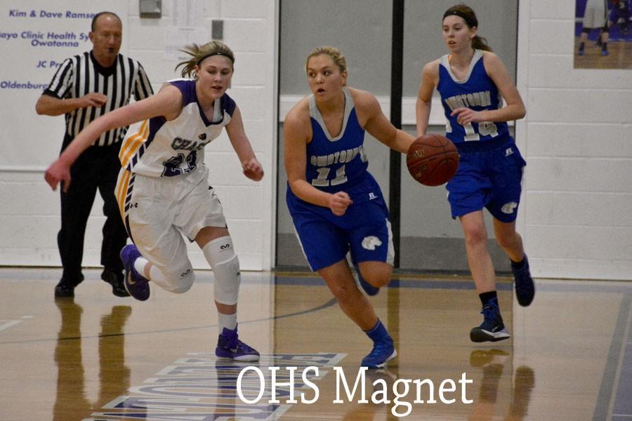 Carli Langeland runs the  ball down the court
