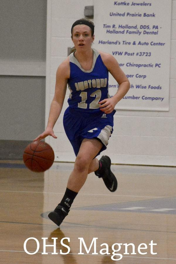 Kirstin Pumper brings the ball down the court after taking it from her opponents
