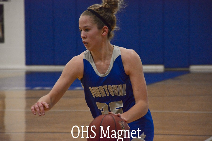Caitlin Anderson takes the ball down the court