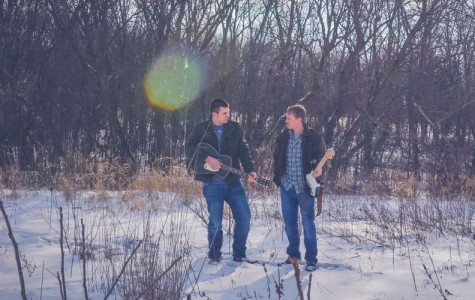 Noah DeKam and Logan Johnson posing with their instruments (used with permission)