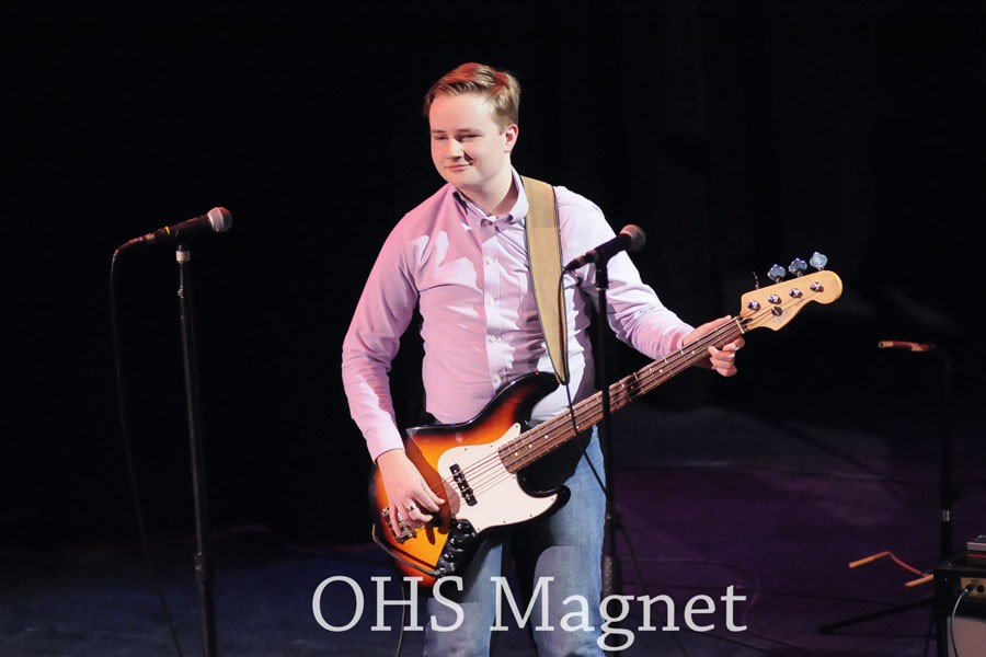Junior Luke Berkley plays the bass in the debut of The Reluctant Scholars