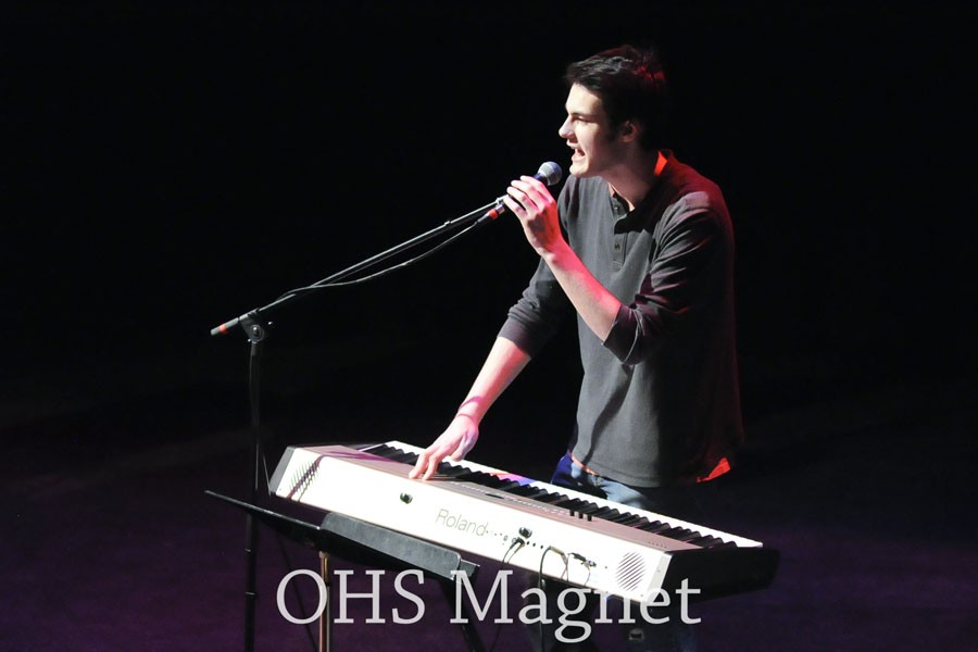 Senior Thomas Donlon playing the keyboard and singing lead  in The Reluctant Scholars
