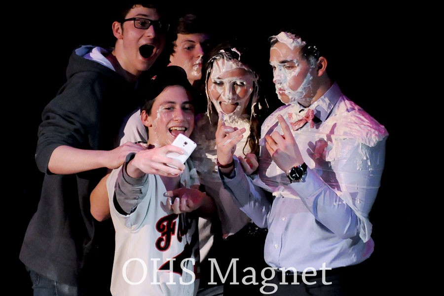 Seniors Peter Jones, Matt Kingland, Jacob Hellevik and Anna Moe take a selfie with freshman Nick Hagen after the #dreamteam get pied in the face