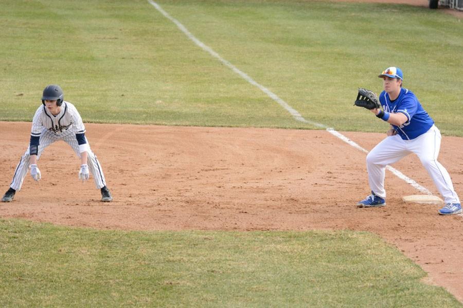 Grant Wehseler holding the runner on base