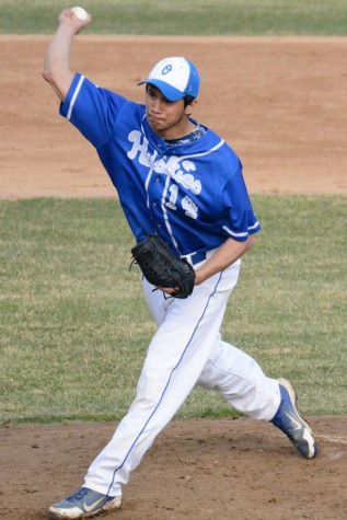 Isaac Rocha pitching the ball