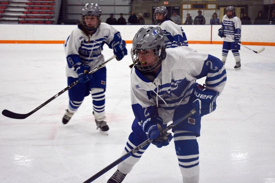 Owatonna girls hockey team sets up for a play