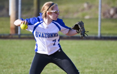 Second baseman Ellie Rohman throws the ball to the first baseman
