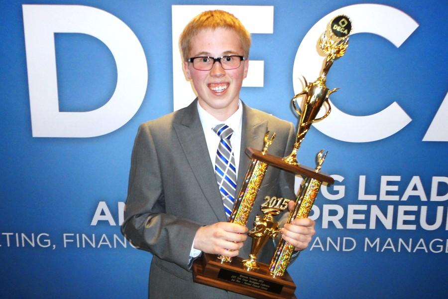 Jack Livingston holding his 1st place trophy at DECA State
