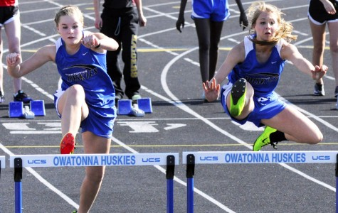 Taylor Velzke and McKenzie Sommers hurdles at the first home meet