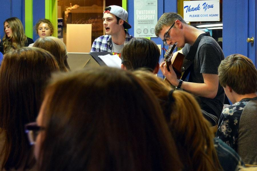 Seniors Thomas Donlon and Jacob Hellevik sing and play guitar