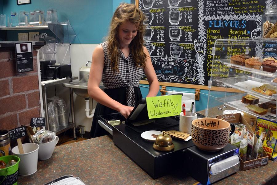 Sophomore Ellen Boisen making change for a customer