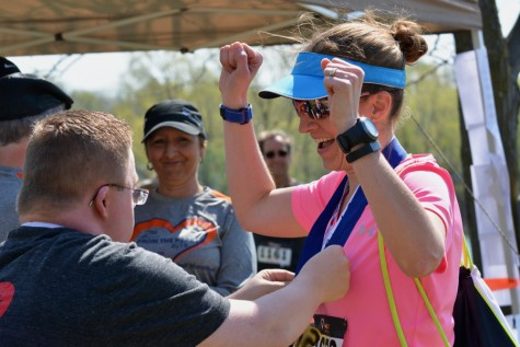 Kristen Andrix celebrates placing first in her age group