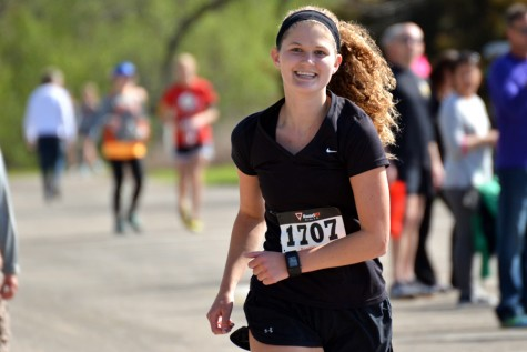 Zoe Kienholz smiles as her friends cheer her on. She placed second in the half marathon in her age group, being beaten by Elena Bueltel