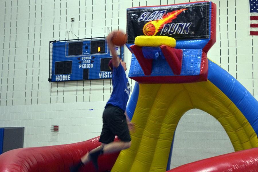 Junior Jacob Borchert slam dunking