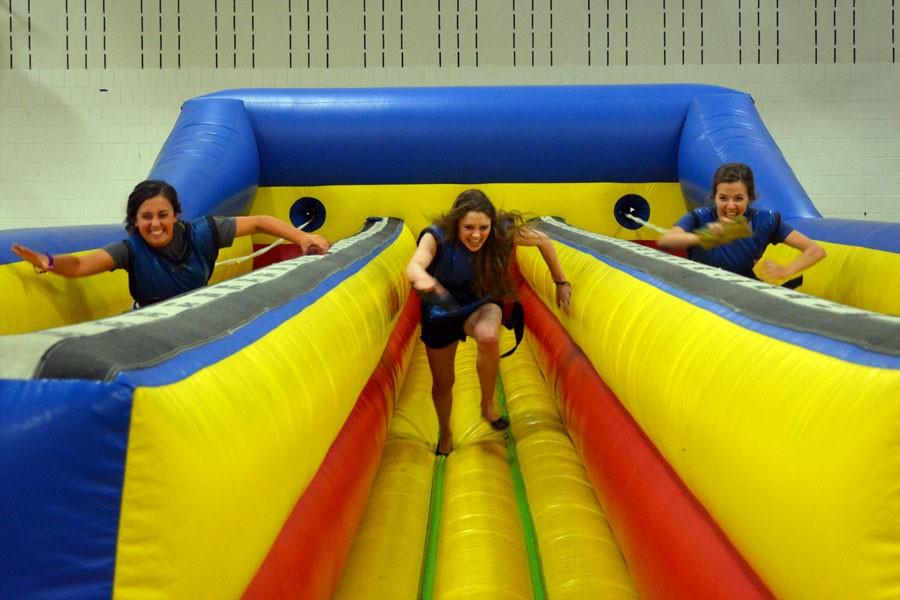 Juniors Cienna Raden, Jaylin Evert and Brooke Otterson racing to the end of a bungee cord track