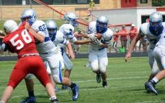 Junior Brandon Moen runs for Owatonna