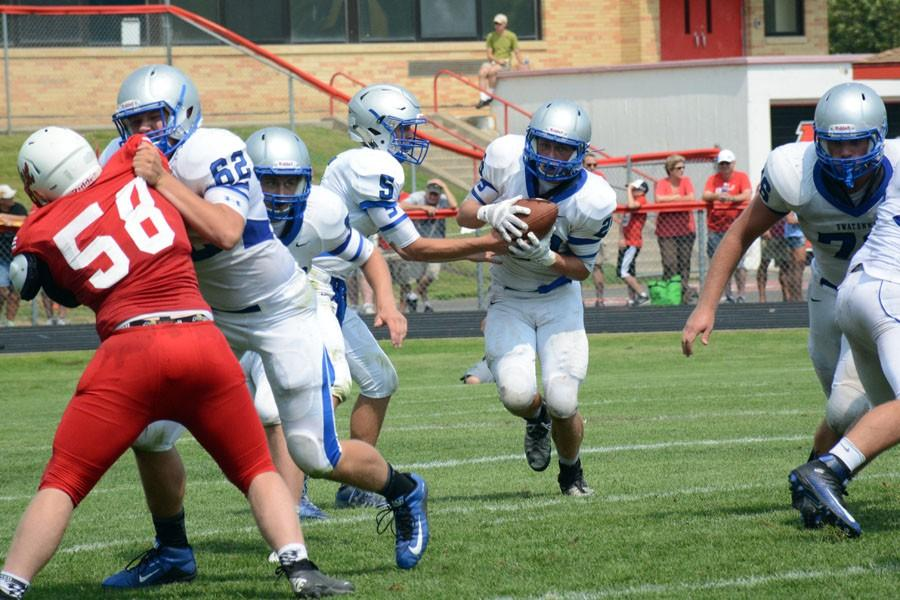 Junior Brandon Moen runs for Owatonna