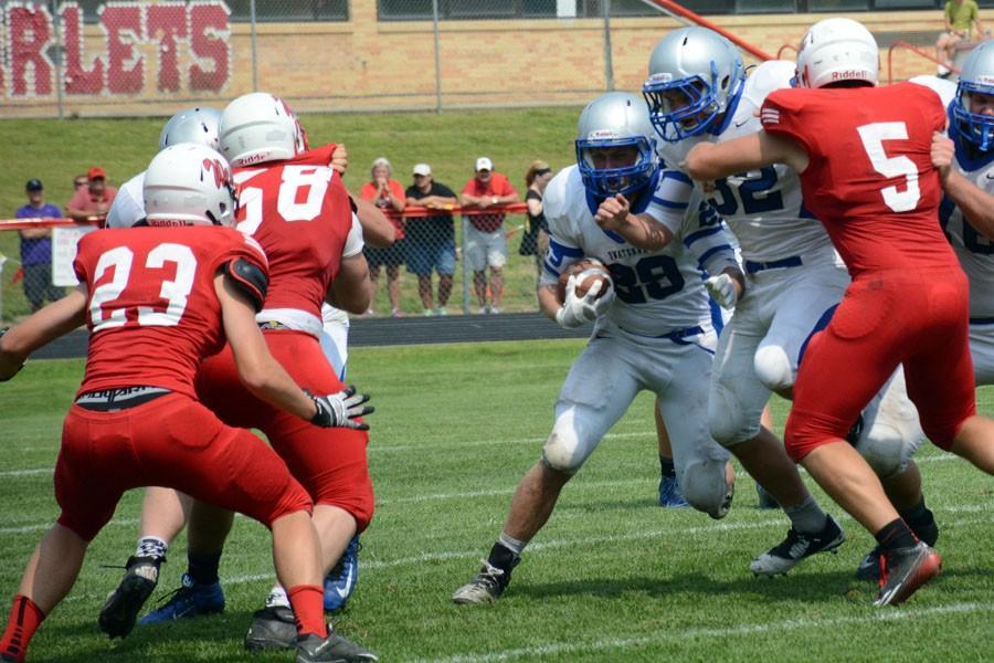 Junior Brandon Moen runs the ball for Owatonna