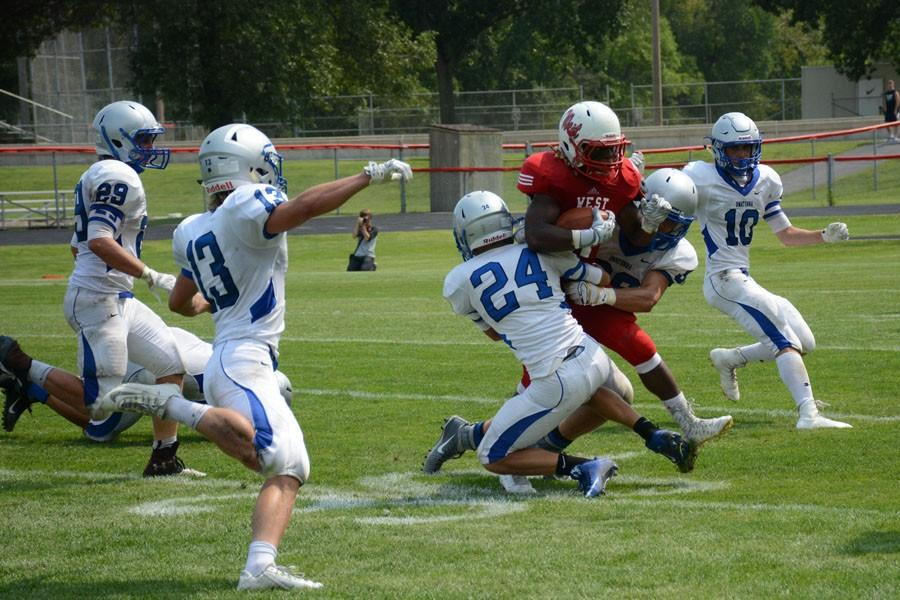 Senior Andrew Peterson makes the tackle on West player