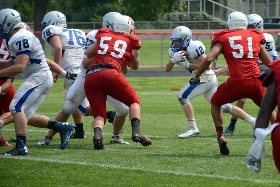 Senior Sam Hylle runs the ball for Owatonna