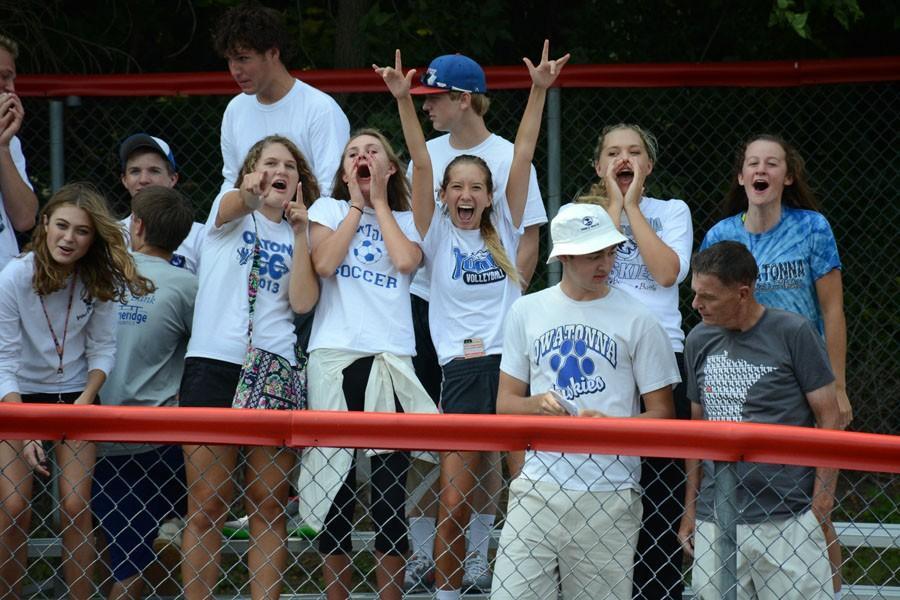 Owatonna seniors cheer for the football team