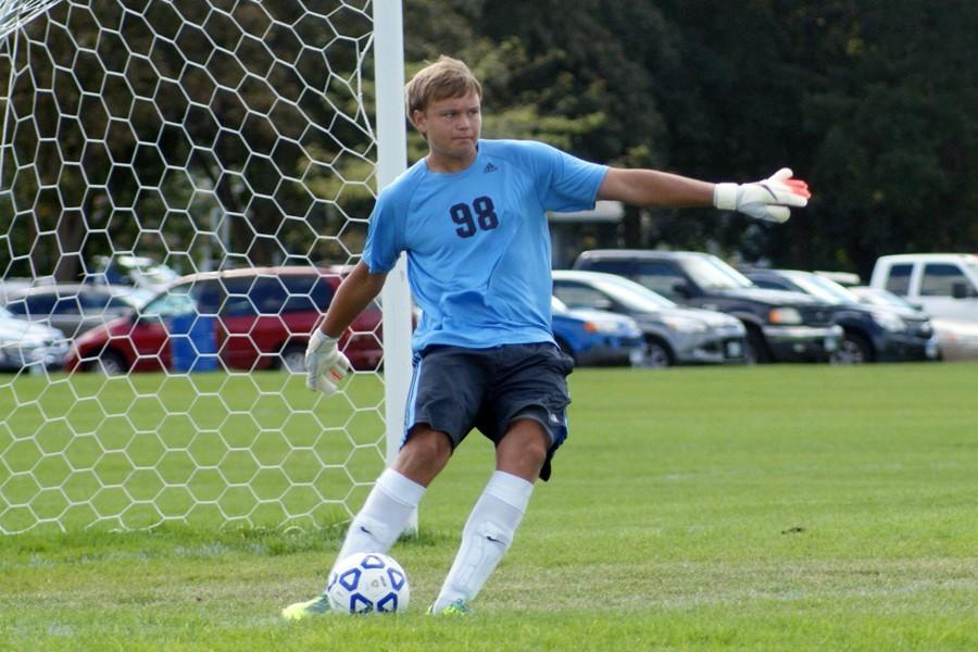 Junior Aidan Buryska kicks the ball to his teammates