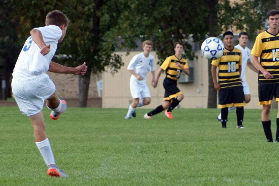 Junior Mitchell Mayer takes a free kick during the first half