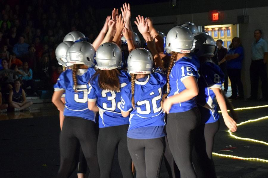 Owatonna students performing a skit during the pepfest