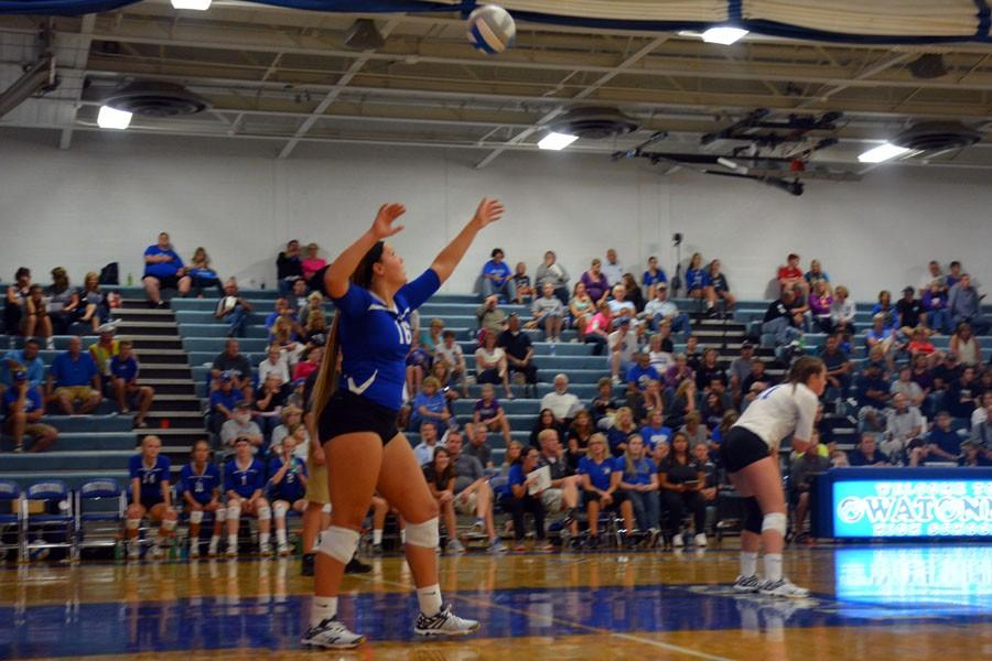 Junior Lexi Langeland serving the volleyball