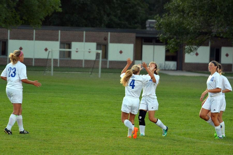 Girls Soccer team celebrates after scoring a goal